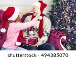 christmas gift. happy couple in ... | Shutterstock . vector #494385070