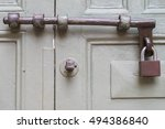 wooden door with lock. | Shutterstock . vector #494386840