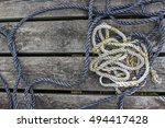 Two Strings Of Rope On Wooden...