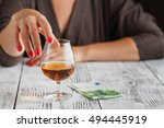 a woman's hand is touching a... | Shutterstock . vector #494445919