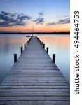 Lake At Sunset  Long Wooden Pier