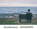 man sitting on bench... | Shutterstock . vector #494469094