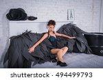 brunette woman   black angel... | Shutterstock . vector #494499793