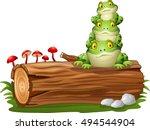 cartoon frog stacked on tree log | Shutterstock .eps vector #494544904