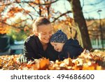 Family In The Autumn Park. Mom...
