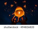 asian cople floating lantern on ... | Shutterstock . vector #494826820