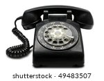 An Old Black Rotary Phone On...