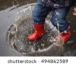 kid in red rubber boots make of ...   Shutterstock . vector #494862589