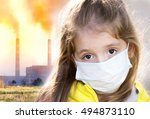 Child in protective mask on industrial plant smoke background.Atmosphere pollution.Factory smog influence on people health concept. - stock photo