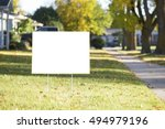 Blank yard sign during sunny...