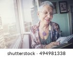 senior lady looking at old... | Shutterstock . vector #494981338