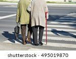 Old Couple Walks On The...