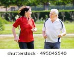 smiling senior couple running...   Shutterstock . vector #495043540