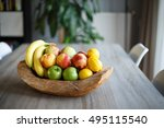 wooden fruit basket on table | Shutterstock . vector #495115540