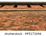 Small photo of Old red brick city wall, part of rampart or vallum, horizontal view