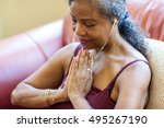senior woman meditating at home | Shutterstock . vector #495267190