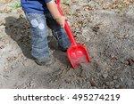 hands kid digging bright red... | Shutterstock . vector #495274219