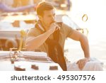 handsome man on a sailing boat... | Shutterstock . vector #495307576