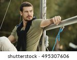 handsome man on a sailing boat... | Shutterstock . vector #495307606