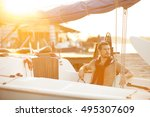 handsome man on a sailing boat...   Shutterstock . vector #495307609