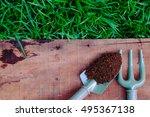 garden tools and peat moss on... | Shutterstock . vector #495367138
