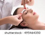 experienced cosmetician pulling ... | Shutterstock . vector #495464350