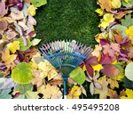 Rake On A Wooden Stick And...