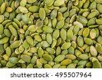 organic pumpkin seeds in a clay ... | Shutterstock . vector #495507964