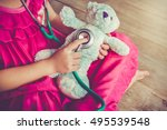 child playing doctor or nurse... | Shutterstock . vector #495539548