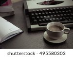 vintage typewriter and coffee... | Shutterstock . vector #495580303