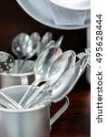 Small photo of Aluminum tablespoons are in an aluminum cup. Soviet aluminum dishes.