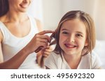 charming little girl is looking ... | Shutterstock . vector #495692320
