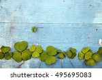 Green Clover Leaf On Wooden...