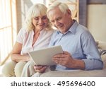 beautiful old couple is using a ... | Shutterstock . vector #495696400