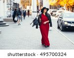 young stylish woman wearing red ...   Shutterstock . vector #495700324
