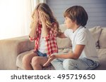 cute little boy is calming... | Shutterstock . vector #495719650