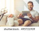 handsome man with broken leg is ... | Shutterstock . vector #495721939