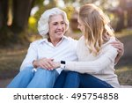 two happy smiling women sitting ... | Shutterstock . vector #495754858