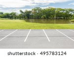 empty parking lot against green ... | Shutterstock . vector #495783124
