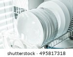 white clean dish on a dish rack | Shutterstock . vector #495817318