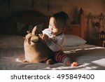 little boy examines a bag of... | Shutterstock . vector #495849400