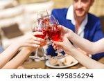 friends drinking wine on the... | Shutterstock . vector #495856294