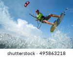 a kite surfer rides the waves  | Shutterstock . vector #495863218