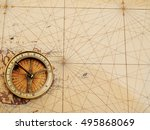old compass over ancient map... | Shutterstock . vector #495868069