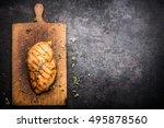 roasted chicken fillet on aged... | Shutterstock . vector #495878560