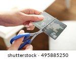 female hands cutting credit...   Shutterstock . vector #495885250