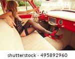 sexy woman sitting in retro car | Shutterstock . vector #495892960