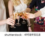 hands holding the glasses of... | Shutterstock . vector #495895018
