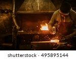 the blacksmith forging the... | Shutterstock . vector #495895144