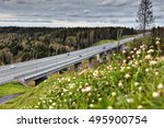 Highway bridge viaduct over the forest stream in the Russian countryside, summer sunny day. - stock photo
